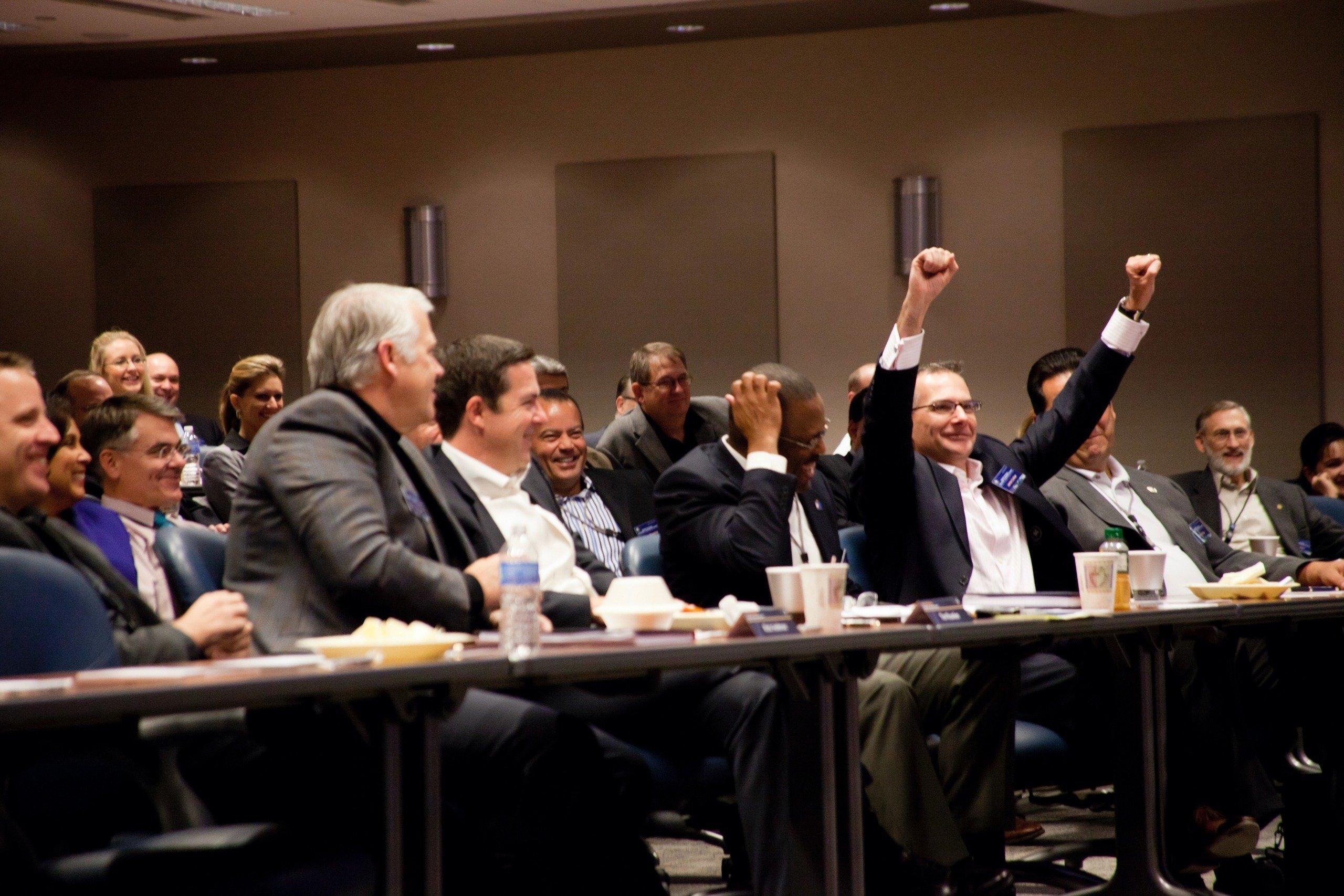 men in the audience of funny motivational speaker